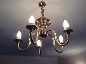 Pair of solid brass chandeliers.