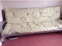 Futon for sale very good condition only used occasionally. Can be dismantled. Colour beige