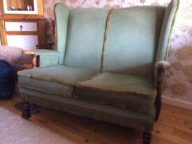 Two seater green Draylon oak framed settee for sale.