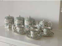 Tea coffee sugar containers inc. tea pot, 4 cups and saucers, salt and pepper pots