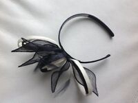 Creme and navy fascinator with feather detail, excellent condition only worn once