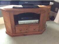 Antique pine reproduction t v and video unit for a big tv. With a storage drawer. In good condition.