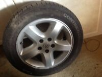 Two Car tyres and one Vauxhall tyre and wheel