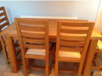4 chairs & oak table some marks on cloth seats excellent condition buyer collects £150.00