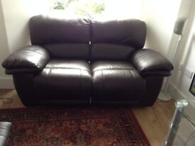 2x 2-seater brown leather reclining sofas.