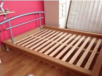 Beech framed low double bed with metal headboard immaculate from smoke free home