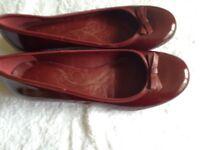 Ladies Clarks maroon flat slip on shoes