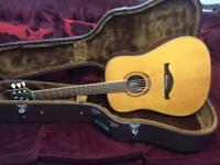 Lag Spring acoustic guitar left handed.