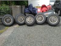 Five Isuzu Trooper wheels and tyres (245-70-R16). Two nearly new, two part worn and one spare.