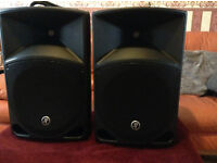 pair of Mackie TH12A Thump active speakers