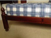 Double Bed - dark wooden frame and mattress