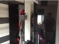 3 door black wardrobe with full length mirror in middle