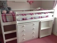 White mid-sleeper bed with pull-out desk & drawers
