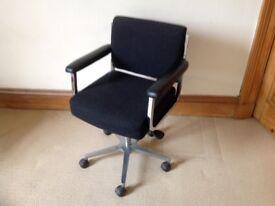 Swivel desk chair in black .