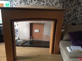 electric fire wuth wooden fire surround and black marble back and hearth