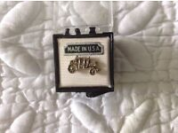 A Brand New Royal Horse Carriage Lapel Badge in its original box