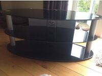 Television table/stand. Black glass and Matt silver ovals, take max 55 inch TV