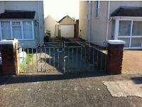 A set of ornate wrought iron driveway gates for sale