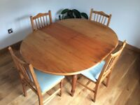 Dining table and chairs.Pine wood. Extending round table 114cms diameter extended 114x 154