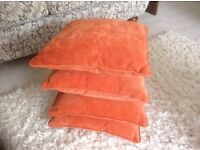 4 burnt orange cushions as new ( cover and pallet ) 17 ins square-piping- concealed zip