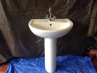 bathroom sink with pedestal and mixer tap