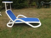 Sun lounger with back support and in built sun shade
