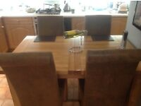Oak dinning table and four chairs