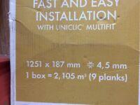 1 box of click vinyl flooring (5 planks and off cuts)