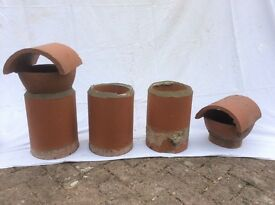 Chimney pots, three terracotta bases, only one tried out. Two terracotta cowl tops