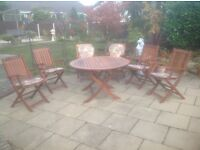 Hardwood Circular table with 6 matching chairs