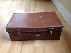 Old fashioned brown suitcase for display or prop use only