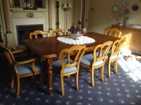 Large extending yew dining table and 8 chairs.