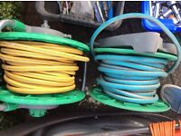 Garden hoses on reels and coiled hoses
