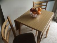 Kitchen table with 2 matching chairs.