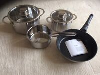 NEFF HIGH QUALITY SET OF FOUR STAINLESS STEEL PANS, NEW AND BOXED