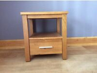 Two solid oak side tables with drawer