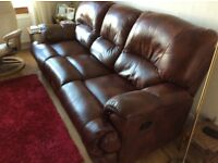 3 seater leather setee wth recliners at either end