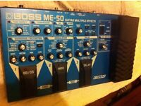 Boss ME50 guitar multi effects with power supply and carry bag.