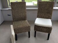Pair of natural rattan chairs.