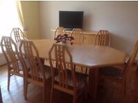 Extending dining table, 8 chairs and sideboard light coloured wood