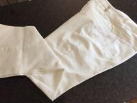 Pair of Next white cotton trousers