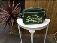 DISTRESSED GENUINE SUPERDRY BAG IN GREEN