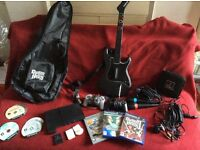 PS2 job lot - console, Guitar Hero, Sing Star hardware, other games, and case...