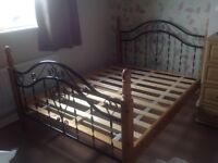 Second hand wood and metal double bed frame.
