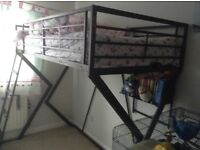 High bed with desk underneath
