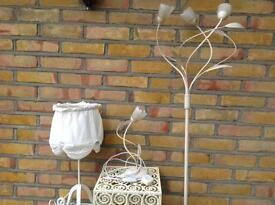 Three figured metal tables, one table lamp and one fancy standard lamp with matching table lamp.