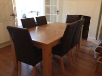 Dining room table & 6 brown leather chairs