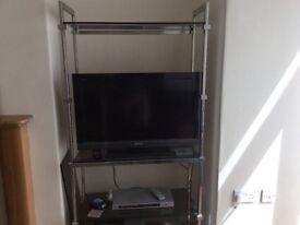 Elegant smoked glass and aluminium shelving unit