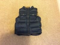 Lovely little boys Gap body warmer. Age 3. Navy blue with checked lining. Great condition.