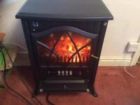 Beautiful almost new log effect electric fire
